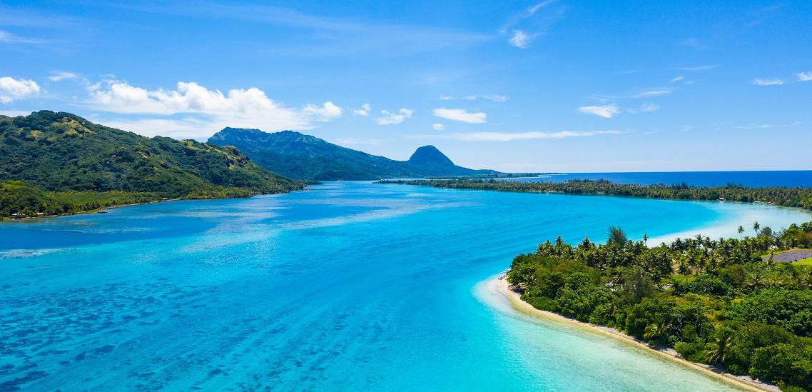 https://tahititourisme.fr/wp-content/uploads/2020/10/Aerial-view-of-Huahine-and-Motu-coral-reef-lagoon-Huahine.jpeg